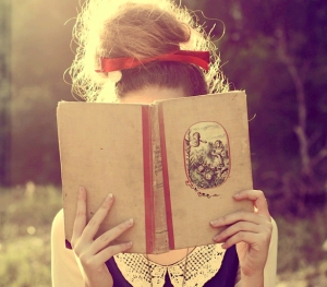 girl-reading-book-outdoors